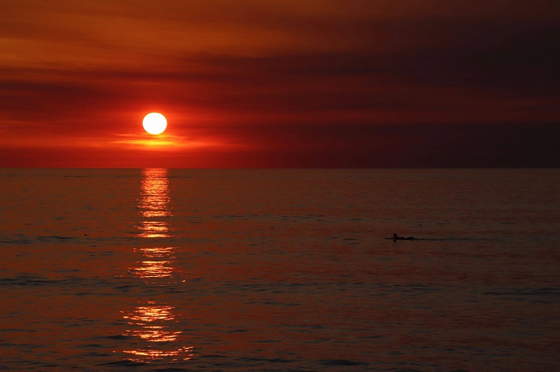 Red, orange and yellow sunset reflection on the ocean